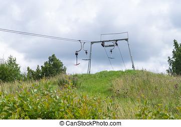 Old empty ski lift in summer landscape