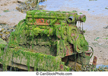 Old engine in mud