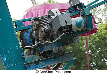 Old engine of ferris wheel in the city park.