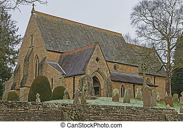 Old English rural village church with graveyard cemetary