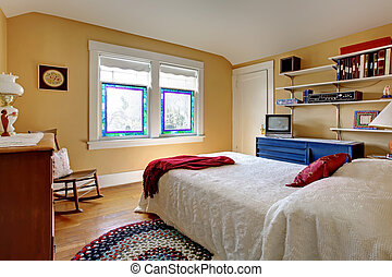 Old English style bedroom with white bed.