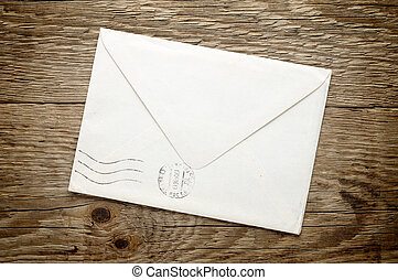 Old envelope on wooden background