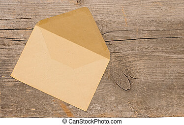 Old envelope on wooden background . With copy space