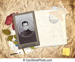 Old envelope, photo and dry rose flower