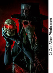 old evil - Medieval plague doctor stands with a skull....