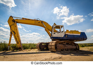 Old Excavator - Old yellow Excavator at Construction Site....