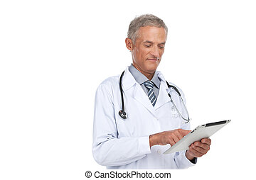 Old experienced doctor reading diagnose. Standing isolated ...