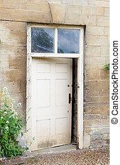 Old external door in a stone wall - Weathered exterior door ...