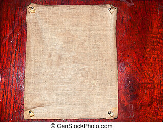 Old Fabric on wood background