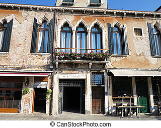 Old facade of a classical building in the historical center of Venice