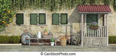 Old facade with gardening tools