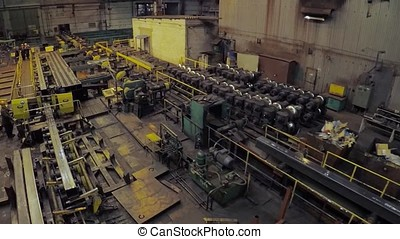 Old factory of auto components production. Warehouse of an aluminum pipes. the production of metal pipes. Pipe welding. Industrial zone, Steel pipelines and equipment. Metal pipes in a warehouse. Stack of steel pipe in factory