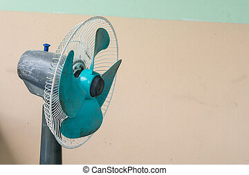 Old fan on wall background