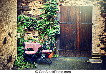 Old farm backyard with table and chairs