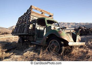 Old farm equipment in a field - old rusty farm equipment in ...