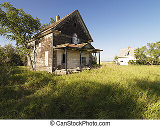 Old Farm house. - Abandoned farm house in rural field.