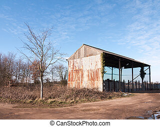 old farm land cow shed blue sky agriculture pen