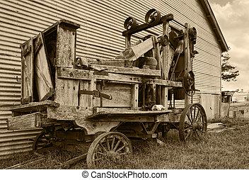 old farm machinery baler
