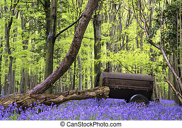 Old farm machinery in vibrant bluebell  Spring forest landscape