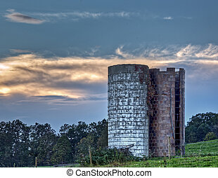 Late summer evening view of old farm silos