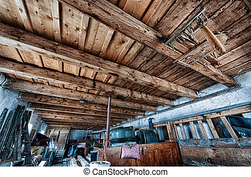 old farm storage room with junk and wooden ceiling