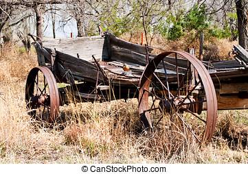 Old farm wagon with Robin