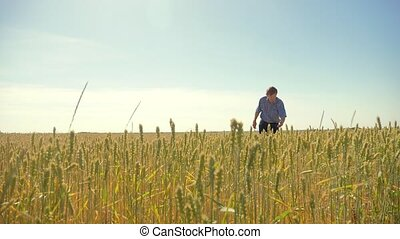old farmer man running in the field agriculture man concept....