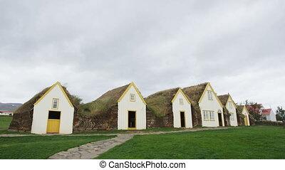 Old Farmhouse Laufas Glaumbaer farm Folk Museum turf roof houses in Varmahlid, Skagafjordur, Iceland, Europe. Icelandic tourist destination and attraction landmark. RED EPIC SLOW MOTION.