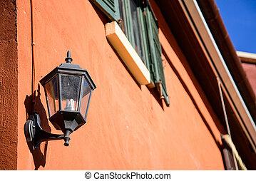 old-fashion lamp hanging on brick wall
