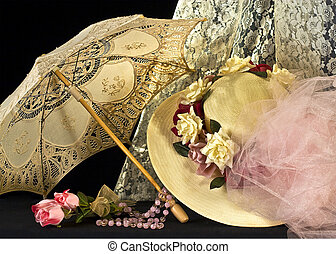 Victorian or old fashion print of hat and parasol with lace and flowers and beads