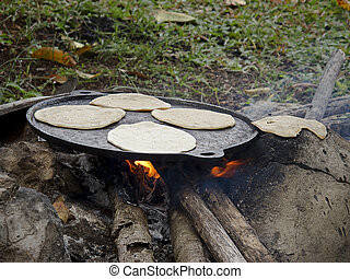 Home made old fashion tortillas cooked on a open fire
