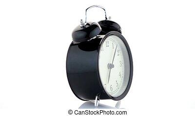 Old fashioned alarm clock on white background.