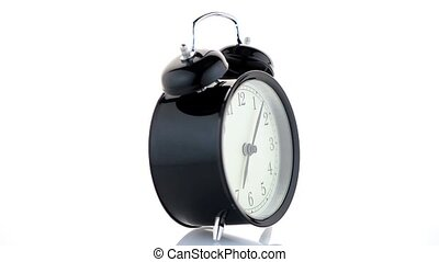 Old fashioned alarm clock on white background.