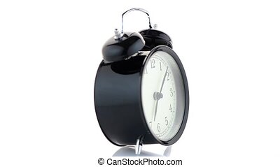 Old fashioned alarm clock ringing on white background.
