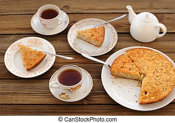Old-fashioned apple pie with black tea