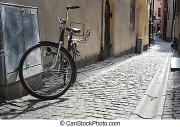 Old fashioned bicycle on old Stockholm street