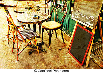 old-fashioned Cafe terrace with tables and chairs,paris...