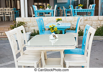 old-fashioned Cafe terrace with tables and chairs