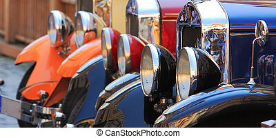 Old fashioned cars. - Three old fashioned cars on the street...