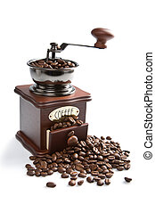 old-fashioned coffee grinder and roasted coffee beans...