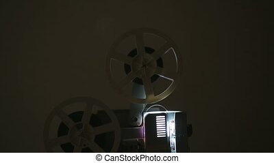 Old-fashioned film projector - Side view of an old-fashioned...