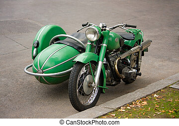 Old fashioned motorcycle with sidecar parked in the street
