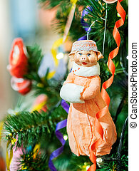 Old fashioned New Year decoration for Christmas tree. Figure...
