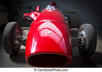 old fashioned red racing car