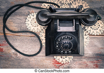Old-fashioned rotary telephone - View from above of a black...
