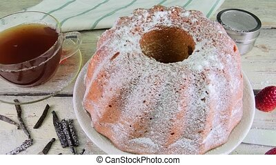 Old fashioned sand cake with cup of black tea and pieces of...