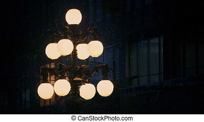 Old Fashioned Streetlight In Snowfall - Beautiful old...
