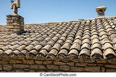 Old fashioned style roof tiles on rural building in Provence France