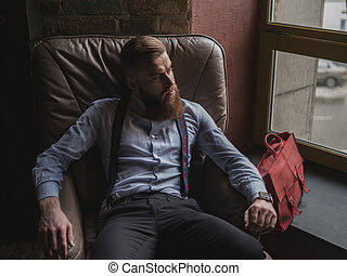 Old-fashioned successful businessman is relaxing at home