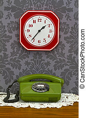 Old fashioned telephone and clock